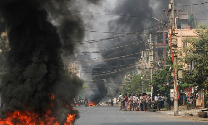 Tires burn on a street as protests against the military coup continue, in Mandalay, Burma, on March 27, 2021. (Stringer/Reuters)