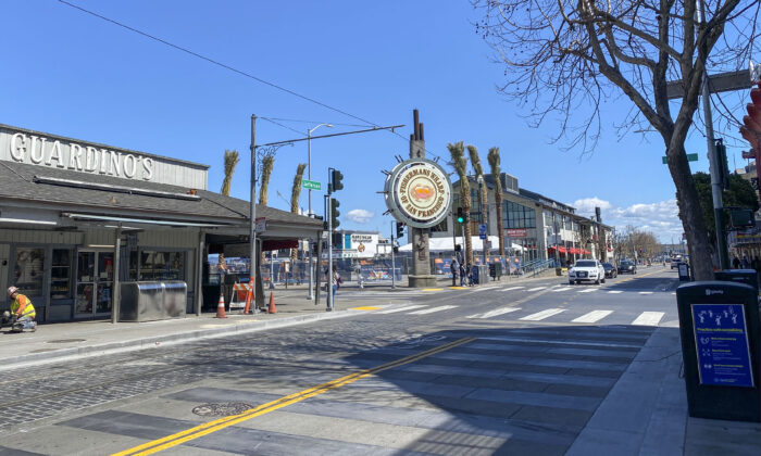 Traffic at Fisherman's Wharf in San Francisco remains slow on March 25, 2021, as the city eases pandemic restrictions into the Orange Tier. (Ilene Eng/The Epoch Times)
