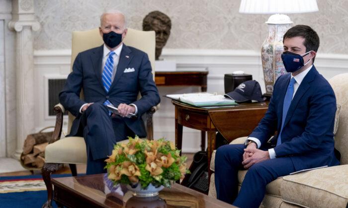 Transportation Secretary Pete Buttigieg (R) meets with President Joe Biden in the White House's Oval Office in Washington on March 4, 2021. (Andrew Harnik/AP Photo)