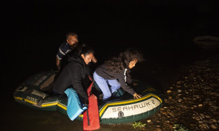 Kaylee Samantha, 7, who said she came alone from Mexico, gets off of a small inflatable raft onto U.S. soil after being delivered by a smuggler in Roma, Texas, on March 24, 2021. (Dario Lopez-Mills/AP Photo)