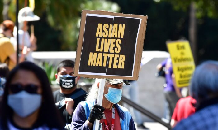 Activists gather for a demonstration at City Hall in Los Angeles on March 27, 2021, denouncing anti-Asian American and Pacific Islander sentiment and hate. (Fredric J. Brown/AFP via Getty Images)