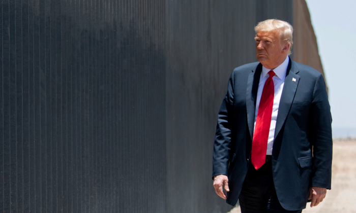 President Donald Trump participates in a ceremony commemorating the 200th mile of border wall at the international border with Mexico in San Luis, Ariz., on June 23, 2020. (Saul Loeb/AFP via Getty Images)