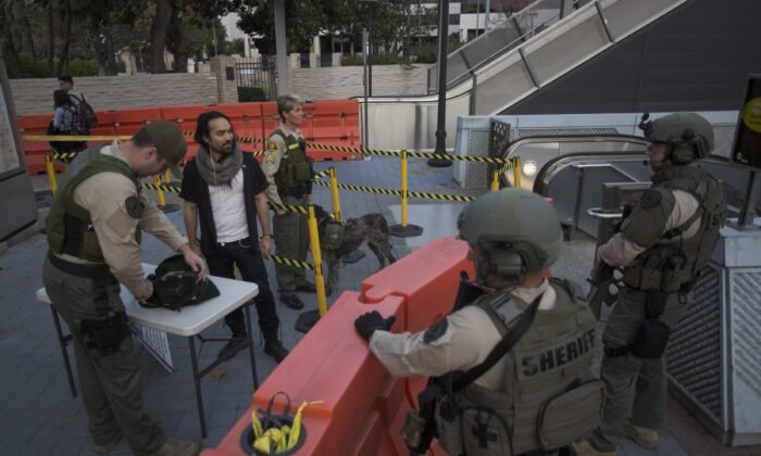 Los Angeles County Sheriff's deputies search a bag at a metro station in Los Angeles, Calif., on Dec. 6, 2016. (David McNew/Getty Images)