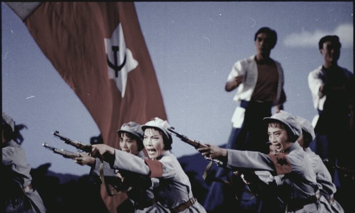 Displayed is a scene from the Red Detachment of Women, a ballet of CCP propaganda. (U.S. National Archives and Records Administration)