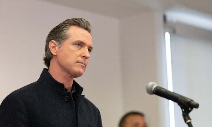 Gov. Gavin Newsom speaks to reporters at AltaMed Urgent Care in Santa Ana, Calif., on March 25, 2021. (John Fredricks/The Epoch Times)