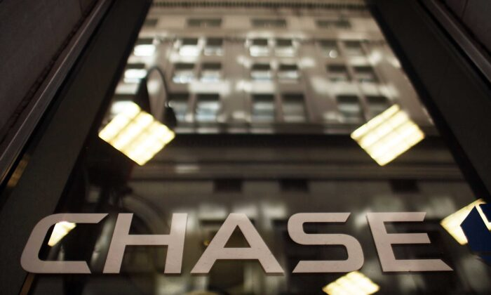 A Chase sign is viewed at a bank branch near the company's New York headquarters, in New York City, on May 11, 2012. (Spencer Platt/Getty Images)