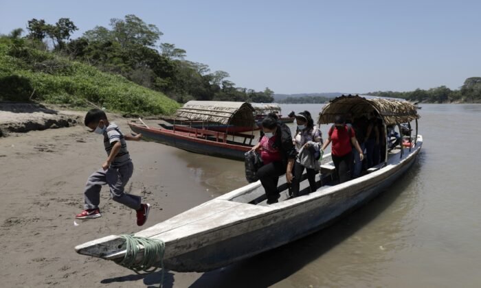 Migrants disembark on the Mexican side of the border after crossing the Usumacinta River from Guatemala, in Frontera Corozal, Chiapas state, Mexico, on March 24, 2021. (Eduardo Verdugo/AP Photo)