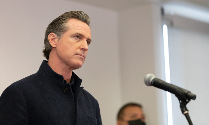 California Gov. Gavin Newsom speaks to reporters at AltaMed Urgent Care in Santa Ana, Calif., on March 25, 2021. (John Fredricks/The Epoch Times)