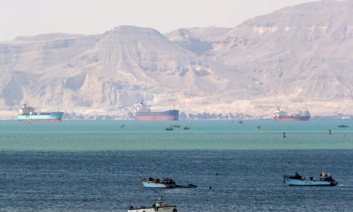 Ships and boats are seen at the entrance of Suez Canal, which was blocked by stranded container ship Ever Given that ran aground, Egypt, on March 28, 2021. (Mohamed Abd El Ghany/Reuters)