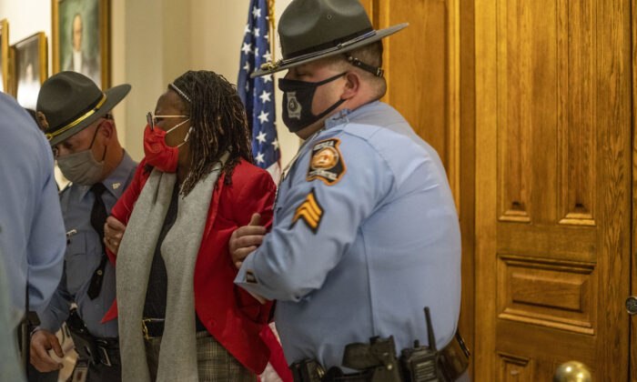 Georgia state Rep. Park Cannon (D-Atlanta) is placed in handcuffs by Georgia State Troopers after being asked to stop knocking on a door that led to Gov. Brian Kemp's office while Kemp was signing a voting restriction bill at the Georgia State Capitol Building in Atlanta on March 25, 2021. (Alyssa Pointer/Atlanta Journal-Constitution/TNS)