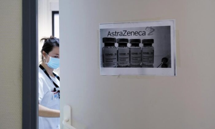 A health worker closes a door as she prepares doses of the AstraZeneca/Oxford vaccine at the Edouard Herriot hospital, on Feb. 6, 2021 in Lyon, central France. (Olivier Chassignole / Associated Press / File)