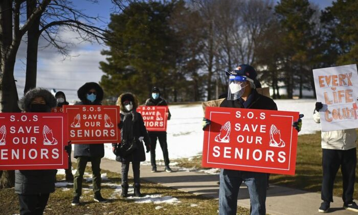 People protest outside the Tendercare Living Centre long-term-care facility during the COVID-19 pandemic in Scarborough, Ont., on December 29, 2020.  (Nathan Denette / The Canadian Press)