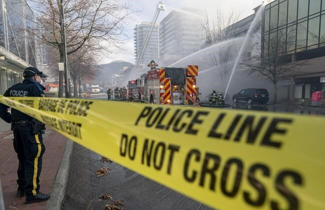Fire fighters attend a fire at a Masonic Temple in North Vancouver, B.C., on March 30, 2021. (Jonathan Hayward/ The Canadian Press)