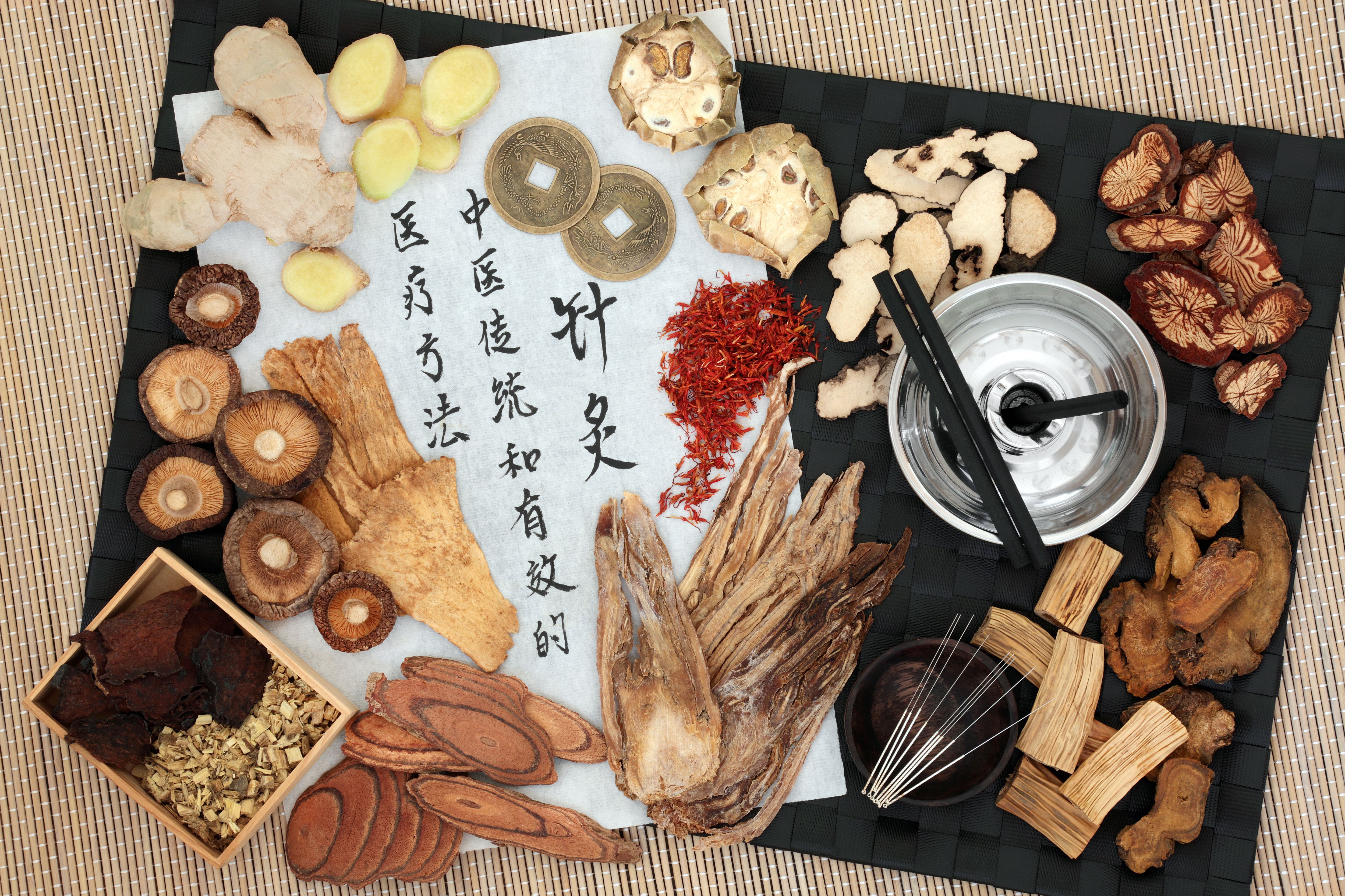 As the characters on the paper read, acupuncture and traditional Chinese medicine offer effective treatment methods.(marilyn barbone/Shutterstock)