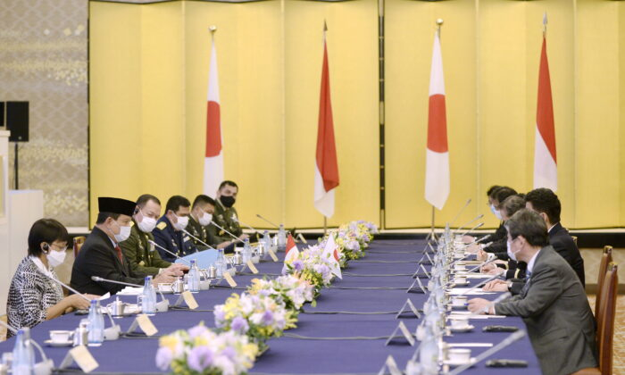 """Indonesian Foreign Minister Retno Marsudi and Defense Minister Prabowo Subianto speak with Japanese Foreign Minister Toshimitsu Motegi and Defense Minister Kishi Nobuo during the """"two-plus-two"""" meeting between Japan and Indonesia at the Iikura Guesthouse of the Foreign Ministry in Tokyo, Japan March 30, 2021. (David Mareuil/Pool via Reuters)"""
