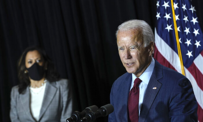 Then-presumptive Democratic vice presidential nominee, U.S. Sen. Kamala Harris listens as presumptive Democratic presidential nominee Joe Biden speaks at the Hotel DuPont in Wilmington, Del., on Aug. 13, 2020. (Drew Angerer/Getty Images)