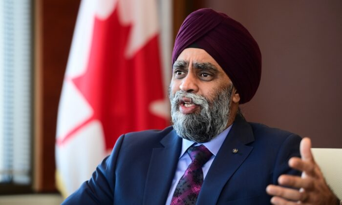Minister of National Defence Harjit Sajjan takes part in a year-end interview with The Canadian Press at National Defence Headquarters in Ottawa on Dec. 17, 2020. (Sean Kilpatrick/The Canadian Press)