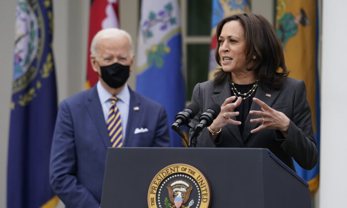 President Joe Biden listens as Vice President Kamala Harris speaks about the American Rescue Plan in the Rose Garden of the White House in Washington. (Alex Brandon/AP Photo)
