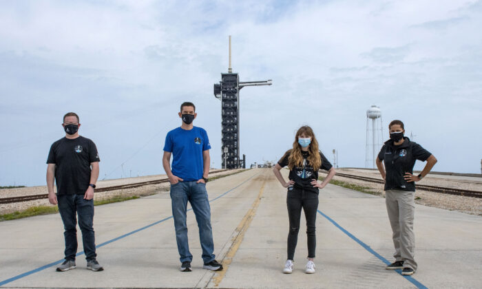 (L-R) Chris Sembroski, Jared Isaacman, Hayley Arceneaux, and Sian Proctor pose for a photo, at the SpaceX launch pad at NASA's Kennedy Space Center at Cape Canaveral, Fla., on March 29, 2021.  (SpaceX via AP)