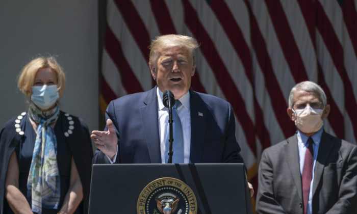 Flanked by White House coronavirus response coordinator Dr. Deborah Birx (L) and Dr. Anthony Fauci (R), director of the National Institute of Allergy and Infectious Diseases,  U.S. President Donald Trump delivers remarks about coronavirus vaccine development in the Rose Garden of the White House in Washington on May 15, 2020. (Drew Angerer/Getty Images)