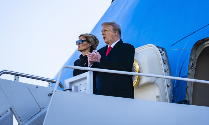 President Donald Trump and First Lady Melania Trump board Air Force One at Joint Base Andrews for the last time as President on Jan. 20, 2021. (Pete Marovich for The New York Times)