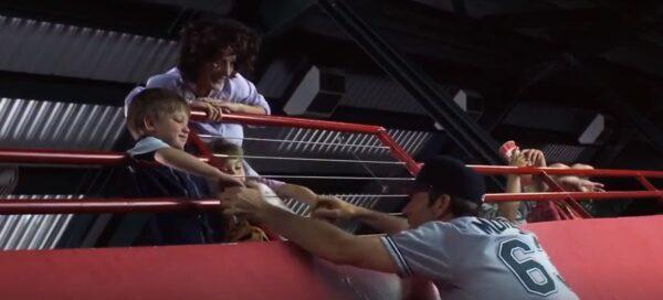 boy, mother, and baseball ball player