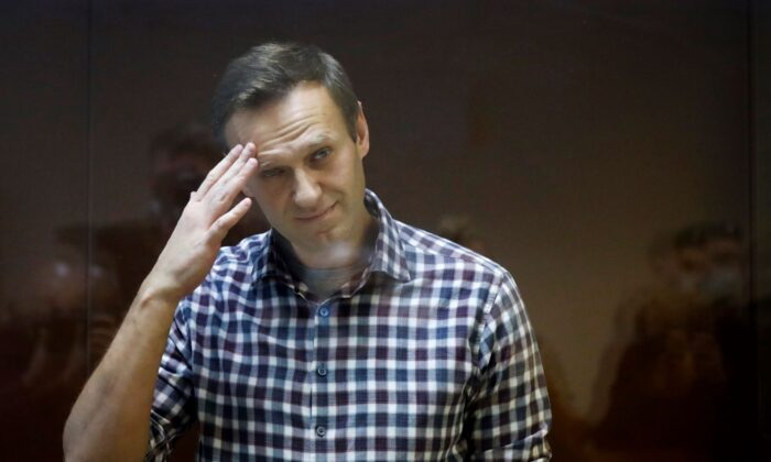 Russian opposition leader Alexei Navalny stands in a cage in the Babuskinsky District Court in Moscow, Russia, on Feb. 20, 2021. (Alexander Zemlianichenko/AP Photo File)