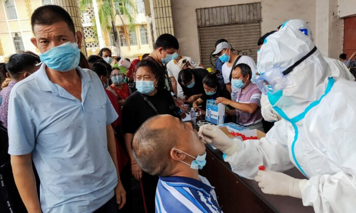 Local residents receive COVID-19 testing in Ruili, southwestern China's Yunnan Province on Sept. 15, 2020. (STR/AFP via Getty Images)