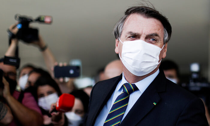 Brazil's President Jair Bolsonaro is seen after a meeting with Brazil's Lower House Arthur Lira at the Planalto Palace, in Brasilia, Brazil, on March 25, 2021. (Ueslei Marcelino/Reuters)