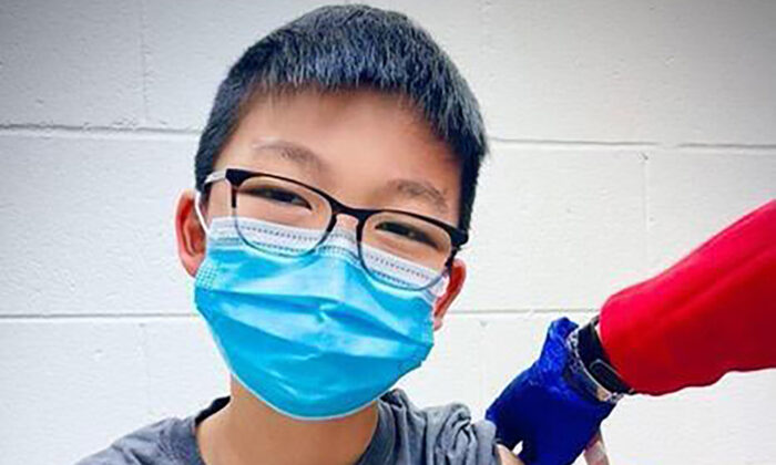 Caleb Chung receives the first dose of Pfizer coronavirus vaccine or placebo as a trial participant for kids ages 12-15, at Duke University Health System in Durham, N.C., on Dec. 22, 2020.  (Richard Chung via AP)