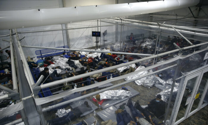 Young minors lie inside a pod at the Donna Department of Homeland Security holding facility, the main detention center for unaccompanied children in the Rio Grande Valley run by the US Customs and Border Protection, ( CBP), in Donna, Texas on March 30, 2021. (Dario Lopez-Mills/AP Photo)