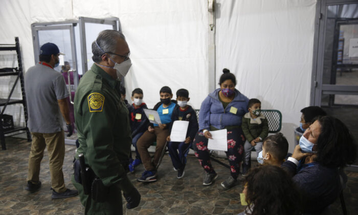 Migrants are processed at the intake area of the U.S. Customs and Border Protection facility, the main detention center for unaccompanied children in the Rio Grande Valley, in Donna, Texas, on March 30, 2021. (AP Photo/Dario Lopez-Mills, Pool)