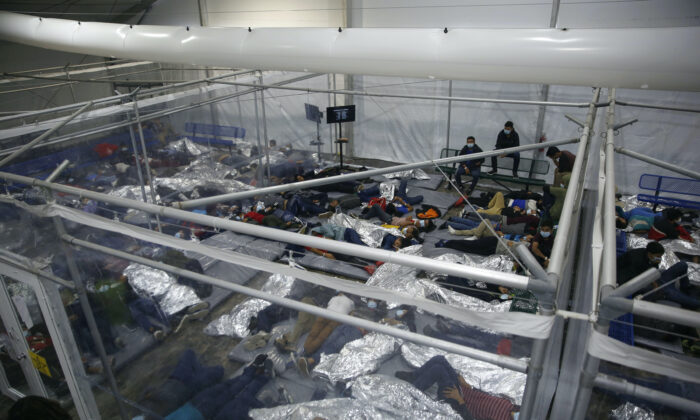 Unaccompanied minors lie inside a pod at a holding facility in Donna, Texas, on March 30, 2021. (Dario Lopez-Mills/AP Photo/Pool)