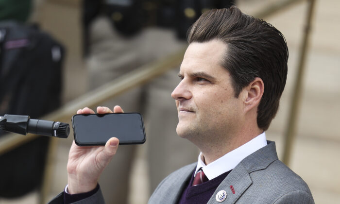 Rep. Matt Gaetz (R-Fla.) holds a phone to the microphone as Donald Trump Jr. speaks remotely to a crowd during a rally against Rep. Liz Cheney (R-WY) in Cheyenne, Wyo., on Jan. 28, 2021. (Michael Ciaglo/Getty Images)