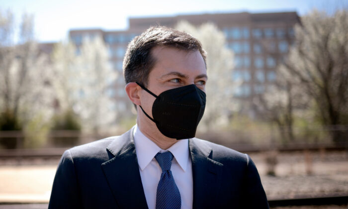 """U.S. Secretary of Transportation Pete Buttigieg attends an event titled """"Transforming Rail in Virginia"""" at the Amtrak-VRE station in Alexandria, Virginia on March 30, 2021. (Win McNamee/Getty Images)"""