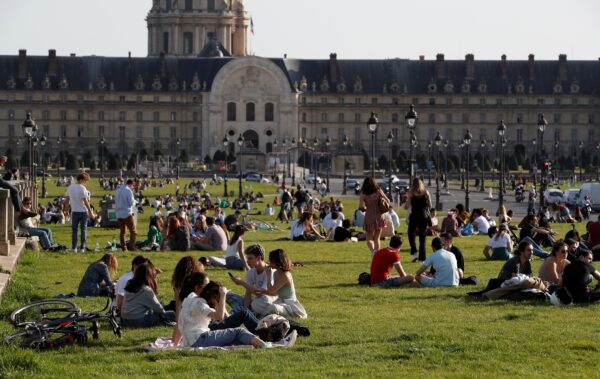 People are enjoying the sunny and warm weather in Paris