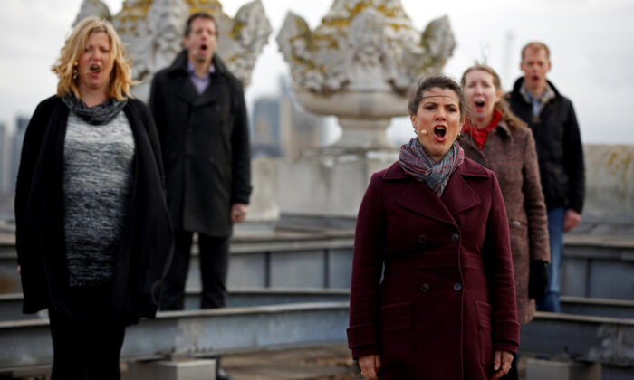 The choir of London's Royal Opera House perform on the rooftop of the Royal Opera House to celebrate Good Friday and the arrival of spring in London, Britain, on March 25, 2021. (John Sibley/Reuters)