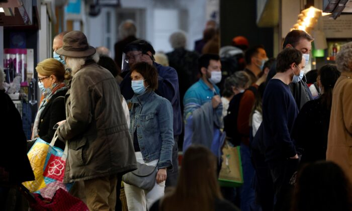 During the COVID-19 outbreak in France on April 1, 2021, people wearing protective masks shop at the local market in Nantes.  (Stephane Mahe / Reuters)