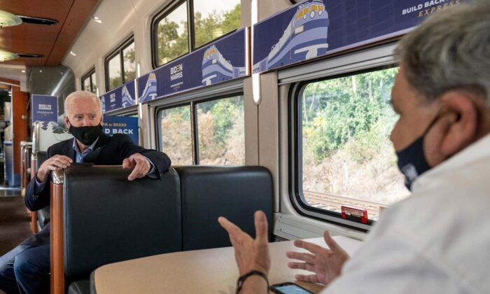 Current U.S. President Joe Biden speaks with United Steelworkers Union President Thomas Conway, right, aboard his train as it travels to Pittsburgh, in this Sept. 30, 2020 file photo. The largest industrial union in North America is vowing to protect Canadian businesses and workers from the perils of protectionism in the United States. (THE CANADIAN PRESS/AP -Andrew Harnik)
