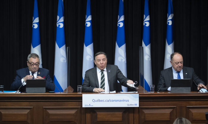 Quebec Premier Francois Legault, centre, speaks during a news conference on the COVID-19 pandemic in Quebec City, Canada, on March 31, 2021. (Jacques Boissinot/The Canadian Press)