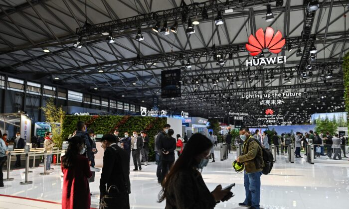 People visit a Huawei booth during the Mobile World Congress in Shanghai on Feb. 23, 2021. (Hector Retamal/AFP via Getty Images)