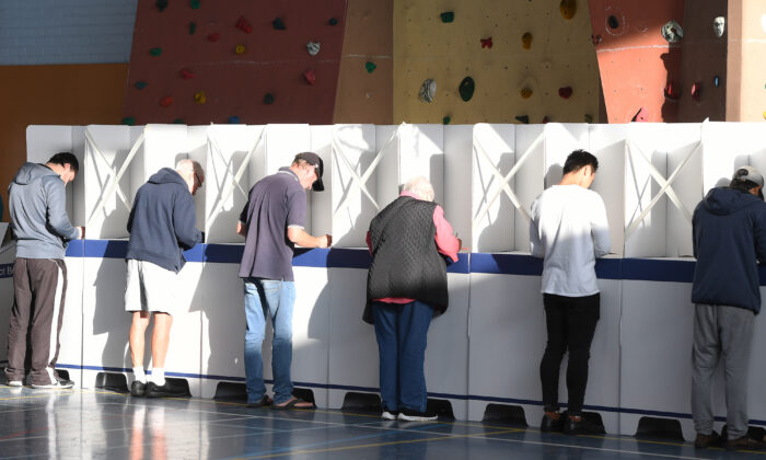 Tasmanians fill out their ballot forms in Hobart, Australia on May 01, 2021 . (Steve Bell/Getty Images)