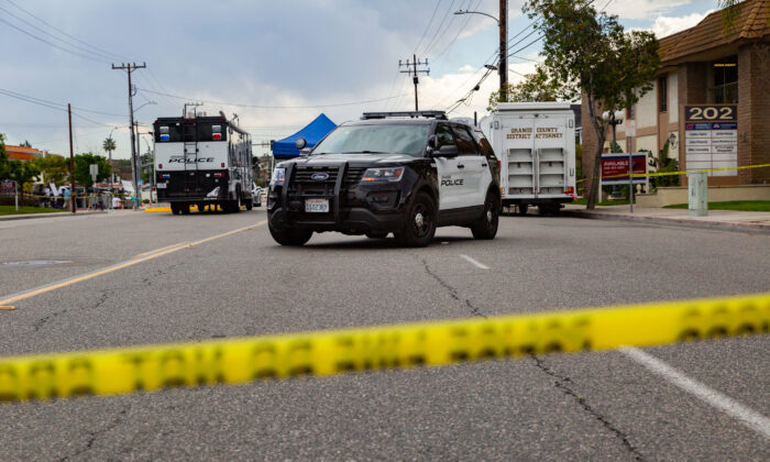 Police investigate the scene of a shooting in Orange, Calif., on April 1, 2021. (John Fredricks/The Epoch Times)