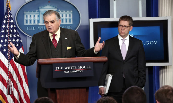 U.S. Secretary of Transportation Ray LaHood (L) answers questions during a briefing as the White House press secretary Jay Carney looks on in Washington on Feb. 22, 2013. (Win McNamee/Getty Images)