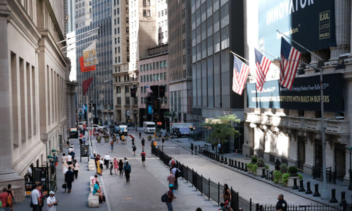 People walk by the New York Stock Exchange  on July 02, 2019. (Spencer Platt/Getty Images)