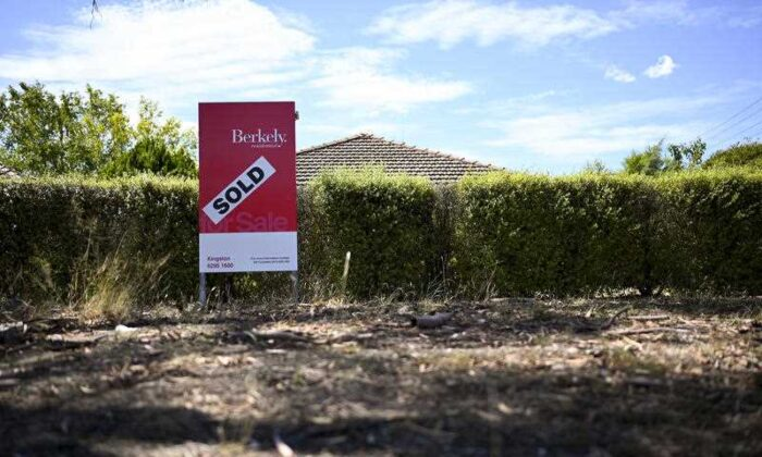 A real estate advertising board is seen next to a house in Canberra, Friday, March 1, 2019. (AAP Image/Lukas Coch)