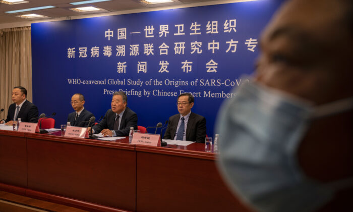Head of the Expert Group on COVID Response at China's National Health Commission Liang Wannian, center, answers a question as he sits with colleagues Feng Zijian, right, Tong Yigan, second left, at a press conference addressing the World Health Organization (WHO) report on the origins of SARS-CoV-2, at the National Health Committee in Beijing, China, on March 31, 2021. (Kevin Frayer/Getty Images)