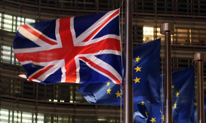 A Union Jack and EU flags fluttering outside the Berlaymont building, the European commission headquarters, on Dec. 9, 2020. (Francois Walschaerts/AFP via Getty Images)
