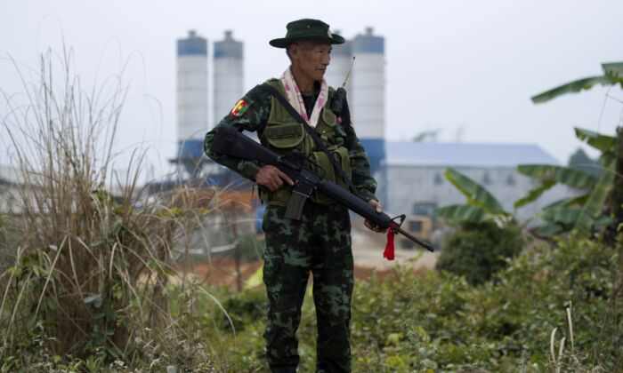 An armed Pan Say militiaman securing a bridge in Muse in Shan state, Burma's main gateway to China, on Jan. 12, 2019. (Ye Aung Thu/AFP via Getty Images)
