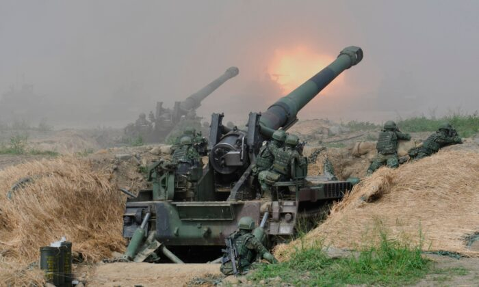 "Two 8-inch self-propelled artillery guns are fired during the 35th ""Han Kuang"" military drill in southern Taiwan's Pingtung county on May 30, 2019. (Sam Yeh/AFP via Getty Images)"